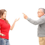 Angry father reprimanding his teenage daughter isolated on white background